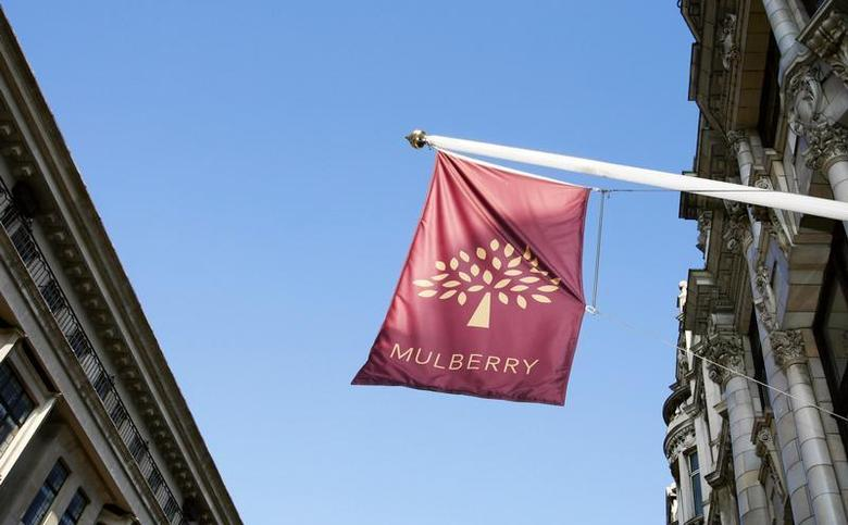 A flag flies above fashion retailer Mulberry's store on New Bond Street in London September 27, 2009. REUTERS/Luke MacGregor