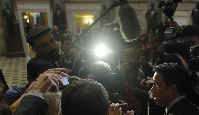 U.S. Representative Michael Grimm (R-NY) (R) talks to the media after meeting with House Speaker John Boehner (R-OH) to discuss the relief fund hold up in Congress for Hurricane Sandy victims at the United States Capitol in Washington January 2, 2013. REUTERS/Gary Cameron