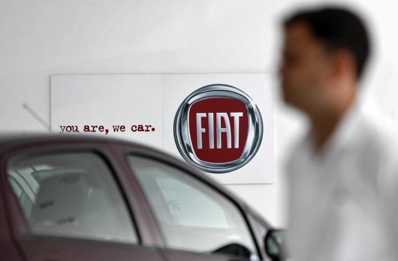 A man walks past a Fiat logo at a showroom in Noida, on the outskirts of New Delhi April 3, 2013. Indian tax officials have opened up a new front in their battle to increase revenue collected from companies, targeting manufacturing firms that slash prices below cost in order to sell slow-moving inventory. REUTERS/Mansi Thapliyal