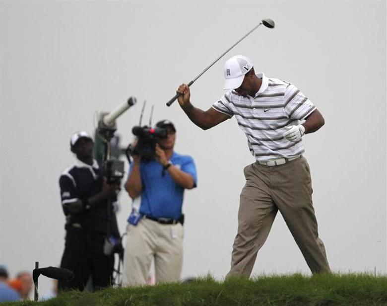 Tiger Woods of the U.S. reacts after his tee shot on the sixth hole during the second round of the 92nd PGA Golf Championship at Whistling Straits in Kohler, Wisconsin August 13, 2010. REUTERS/Matt Sullivan