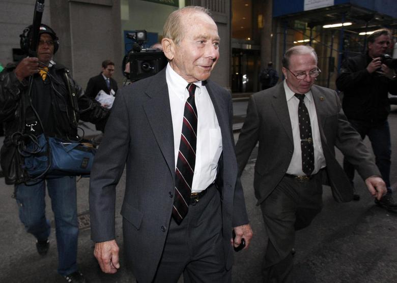 Former CEO of American International Group Inc., Maurice ''Hank'' Greenberg, (C) leaves a building in downtown New York after being deposed by the Attorney General's office March 10, 2010 file photo. REUTERS/Jessica Rinaldi