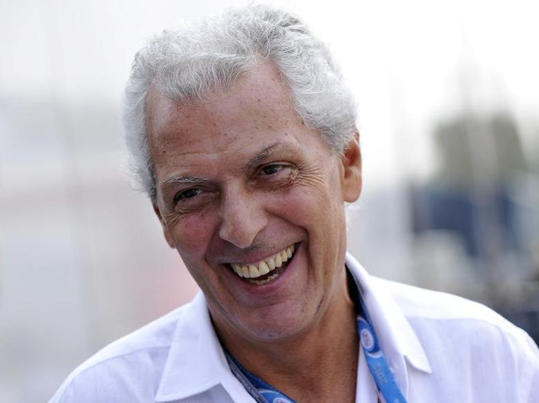 Pirelli president Marco Tronchetti Provera smiles in the paddock after the third practice session of the Italian F1 Grand Prix at the Monza circuit September 8, 2012 file photo. REUTERS/Giorgio Perottino