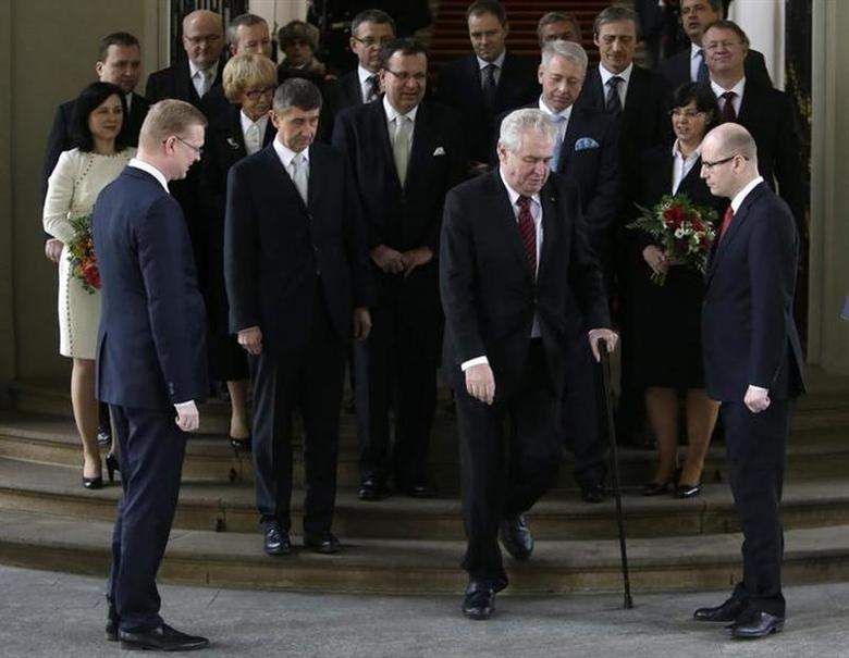 Czech President Milos Zeman (front 2nd R) walks with the aid of a cane as he leaves after posing for a group photo with members of the newly appointed cabinet at Prague Castle in Prague January 29, 2014 REUTERS/David W Cerny