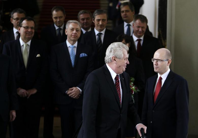 Czech President Milos Zeman (front L) speaks with newly appointed Prime Minister Bohuslav Sobotka (R), as members of the new government pose for a group photo after the cabinet's inauguration at Prague Castle in Prague January 29, 2014. REUTERS/David W Cerny