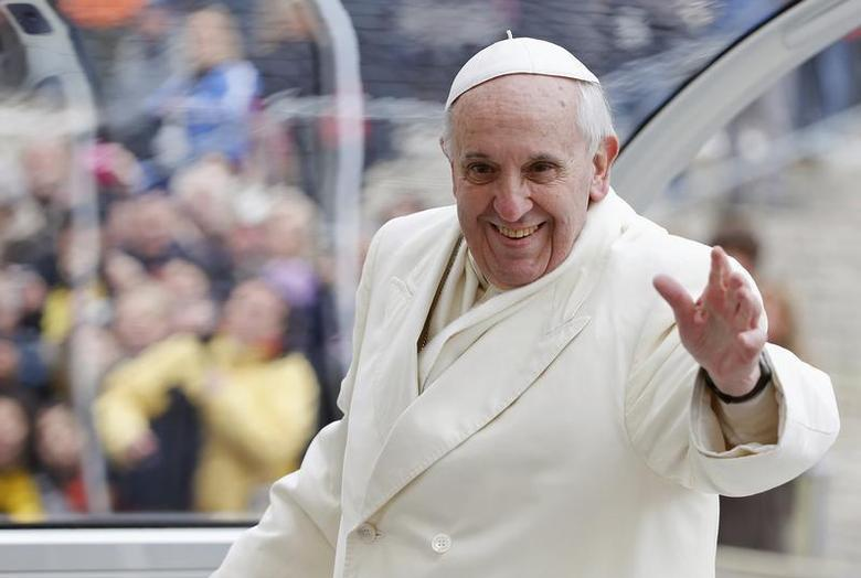 Pope Francis waves as he leaves at the end of his general audience in Saint Peter's Square at the Vatican January 29, 2014. REUTERS/Tony Gentile