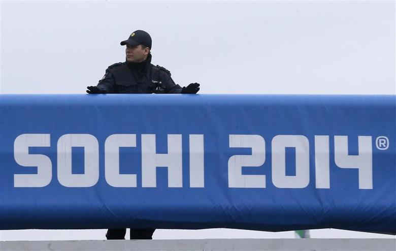 A Russian police officer keeps watch at the Olympic Park in the Adler district of Sochi January 29, 2014. REUTERS/Alexander Demianchuk