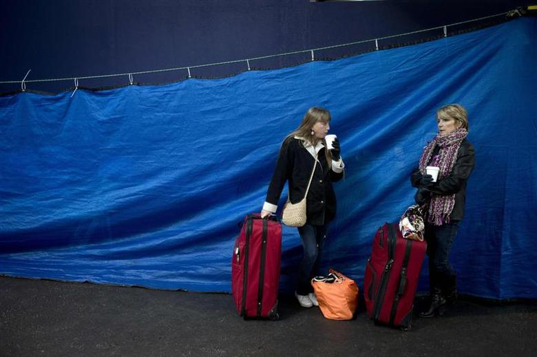 Passengers wait in the departure lounge after Royal Caribbean's Explorer of the Seas arrived back at Bayonne, New Jersey January 29, 2014. REUTERS/Carlo Allegri
