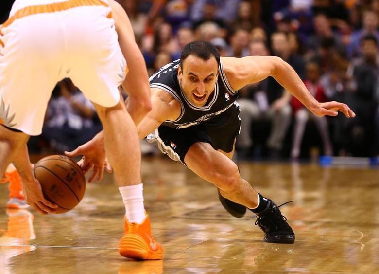 Dec 18, 2013; Phoenix, AZ, USA; San Antonio Spurs forward Manu Ginobili dives for a loose ball in the second half against the Phoenix Suns at US Airways Center. Mark J. Rebilas-USA TODAY Sports