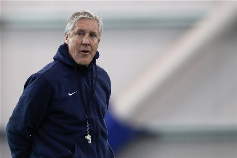 Seattle Seahawks head coach Pete Carroll looks on during their NFL Super Bowl XLVIII football practice in East Rutherford, New Jersey, January 29, 2014. REUTERS/Shannon Stapleton
