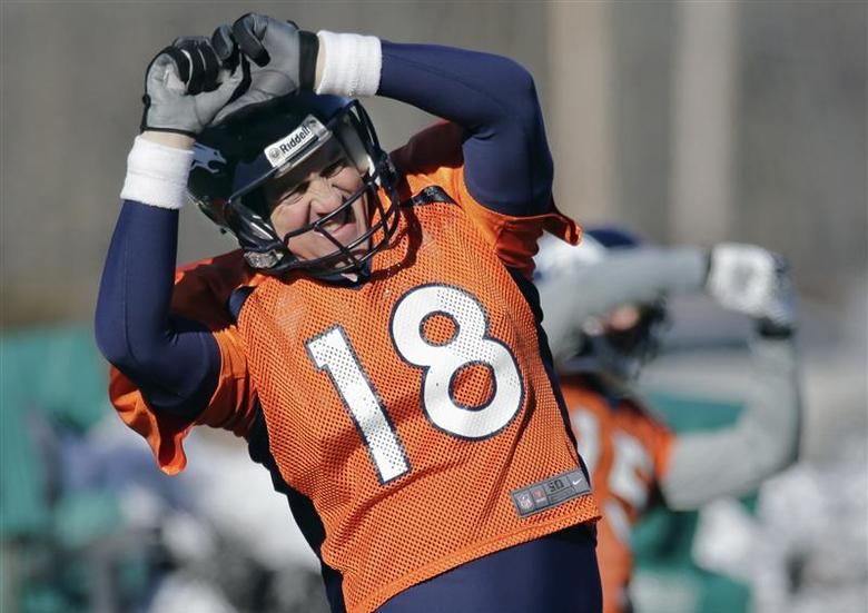 Denver Broncos quarterback Peyton Manning (18) does a stretching exercise during their practice session for the Super Bowl at the New York Jets Training Center in Florham Park, N.J., January 29, 2014. REUTERS/Ray Stubblebine