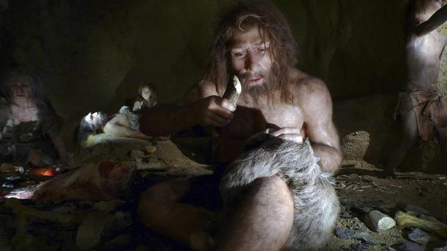 An exhibit shows the life of a neanderthal family in a cave in the new Neanderthal Museum in the northern town of Krapina February 25, 2010. REUTERS/Nikola Solic/Files
