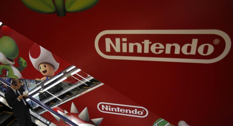 A shopper rides the escalator past Nintendo advertisements at an electronics retail store in Tokyo January 20, 2014. REUTERS/Yuya Shino