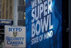 An NYPD Security camera sign is posted along Superbowl Blvd. ahead of Super Bowl XLVIII in New York January 29, 2014. REUTERS/Brendan McDermid