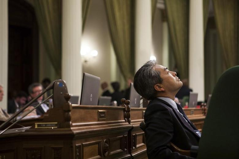 California Assemblymember Al Muratsuchi (D-Los Angeles) listens to arguments in favor and opposition to AB10, a bill that raises the California minimum wage to $10 an hour, at the State Capitol in Sacramento, California, September 12, 2013. REUTERS/Max Whittaker