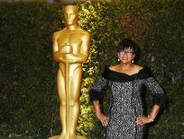 Cheryl Boone Isaacs, president of the Academy of Motion Picture Arts and Sciences, arrives at the 5th Annual Academy of Motion Picture Arts and Sciences Governors Awards in Hollywood November 16, 2013. REUTERS/Fred Prouser
