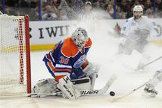 Jan 29, 2014; Edmonton, Alberta, CAN; Edmonton Oilers goalie Ben Scrivens (30) stops a shot during the third period against the San Jose Sharks at Rexall Place. Candice Ward-USA TODAY Sports