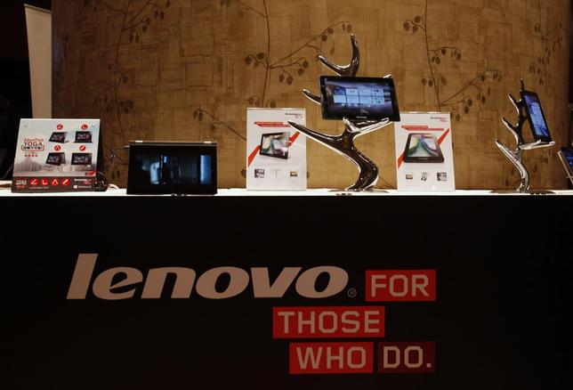 Lenovo tablets and mobile phones are displayed during a news conference on the company's annual results in Hong Kong in this May 23, 2013 file photograph. REUTERS/Bobby Yip/Files