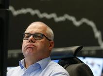 Трейдер на торгах биржи во Франкфурте-на-Майне 29 января 2014 года. Европейские фондовые рынки снижаются из-за опасений за развивающиеся страны и слабых квартальных показателей компаний. REUTERS/Ralph Orlowski