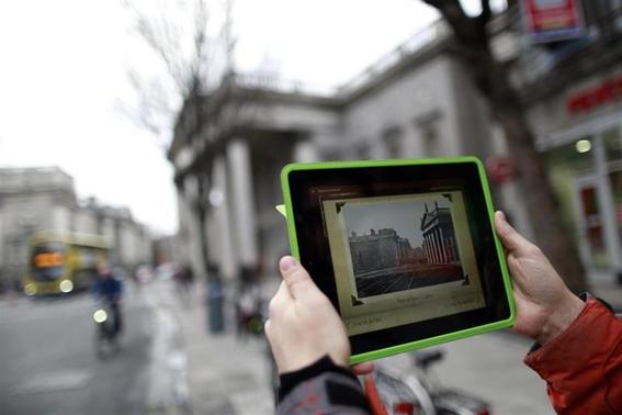A man demonstrates an app to accompany James Joyce's classic story The Dead in central Dublin. January 23, 2014. REUTERS/Cathal McNaughton