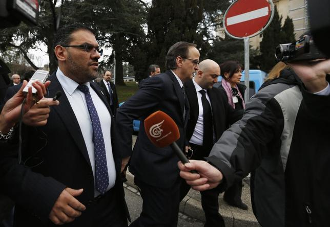 Members of the Syrian opposition delegation Anas al-Abdah (L) and Hadi al-Bahra (C) speak to journalists as they arrive for their first meeting face-to-face with Syrian government delegation and the U.N.-Arab League envoy for Syria Lakhdar Brahimi (not pictured) at a U.N. office in Geneva January 25, 2014. REUTERS/Jamal Saidi