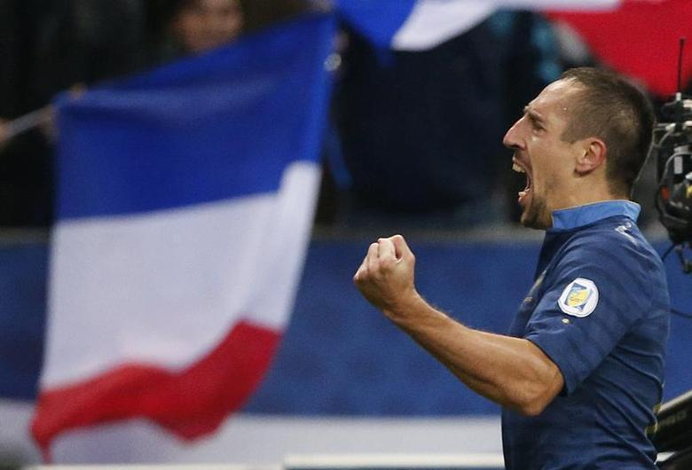 France's Franck Ribery celebrates after scoring against Finland during the 2014 World Cup qualiying soccer match at the Stade de France stadium in Saint-Denis, near Paris, October 15, 2013. REUTERS/Charles Platiau