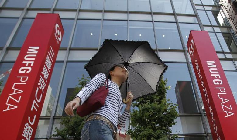 A woman walks past a branch of Mitsubishi UFJ Financial Group (MUFG), Japan's largest bank by assets, in Tokyo May 18, 2010. REUTERS/Yuriko Nakao