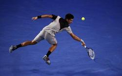 Novak Djokovic of Serbia hits a return to Stanislas Wawrinka of Switzerland during their men's singles quarter-final tennis match at the Australian Open 2014 tennis tournament in Melbourne January 21, 2014. REUTERS/David Gray
