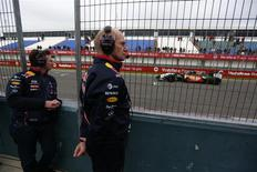 Red Bull Formula One technical chief Adrian Newey (R) and team principal Christian Horner stand in the paddock during pre-season testing at the Jerez racetrack in southern Spain January 28, 2014. REUTERS/Marcelo del Pozo