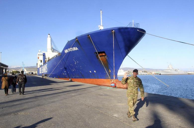 One of two cargo ships intended to take part in a Danish-Norwegian mission to transport chemical agents out of Syria docks in Limassol, December 14, 2013. REUTERS/Andreas Manolis