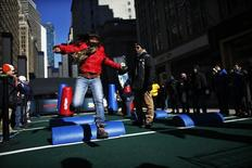 Fans play in the Super Bowl Boulevard fan zone ahead of the Super Bowl XLVIII in New York January 30, 2014. REUTERS/Eduardo Munoz