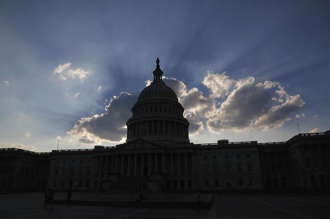 The sun sets behind the U.S. Capitol in Washington October 6, 2013. REUTERS/Jonathan Ernst