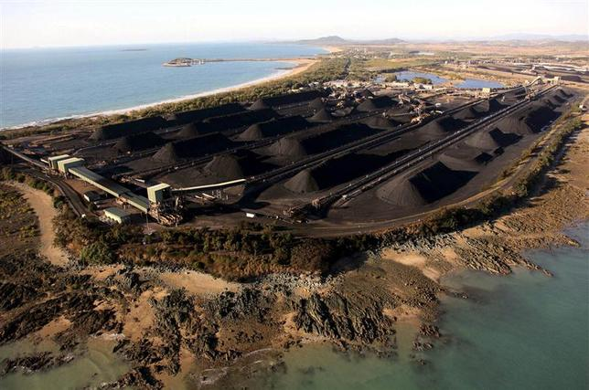 Mounds of coal can be seen along the coastline of Queensland at the port of Hay Point, located around 450 km (279 miles) southeast of the city of Townsville August 5, 2009. REUTERS/Greenpeace/Patrick Hamilton/Handout via Reuters