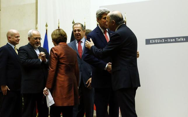 Iranian Foreign Minister Mohammad Javad Zarif (2nd L) talks with European Union foreign policy chief Catherine Ashton (3rd L) next to British Foreign Secretary William Hague (L). Russia's Foreign Minister Sergei Lavrov (3rd R), U.S. Secretary of State John Kerry (2nd R) and French Foreign Affairs Minister Laurent Fabius (R) after a ceremony at the United Nations in Geneva November 24, 2013. REUTERS/Denis Balibouse