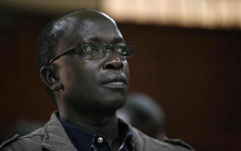 Kenyan journalist Walter Barasa attends a court session at the Milimani Law court in Nairobi, where he filed an application to stop his arrest and being handed over to the International Criminal Court, October 9, 2013. REUTERS/Gregory Olando