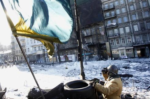 Ukraine's Yanukovich, on sick leave, signs laws linked to protests