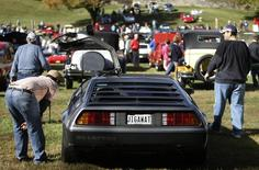 Admirers inspect a 1981 DeLorean DMC-12 at the annual Rockville, Maryland Antique and Classic Car show October 20, 2012. REUTERS/Gary Cameron
