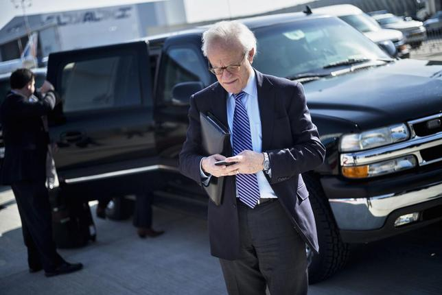 U.S. Special Envoy for Israeli-Palestinian Negotiations Martin Indyk checks his mobile phone while waiting for U.S. Secretary of State John Kerry to board his plane at Ben Gurion International Airport in Tel Aviv January 6, 2014. REUTERS/Brendan Smialowski/Pool