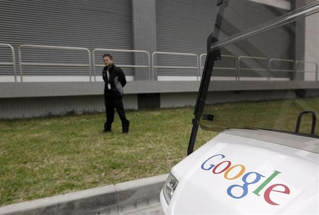 A security personnel stands guard during the media tour in the Google data centre in Changhua Coastal Industrial Park, central Taiwan, December 11, 2013. REUTERS/Pichi Chuang/Files