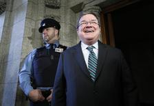 Canada's Finance Minister Jim Flaherty laughs while speaking with journalists in the foyer of the House of Commons on Parliament Hill in Ottawa January 28, 2014. REUTERS/Chris Wattie