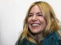Actress Sienna Miller arrives for the Matthew Williamson Spring/Summer 2014 collection presentation during London Fashion Week September 15, 2013. REUTERS/Suzanne Plunkett