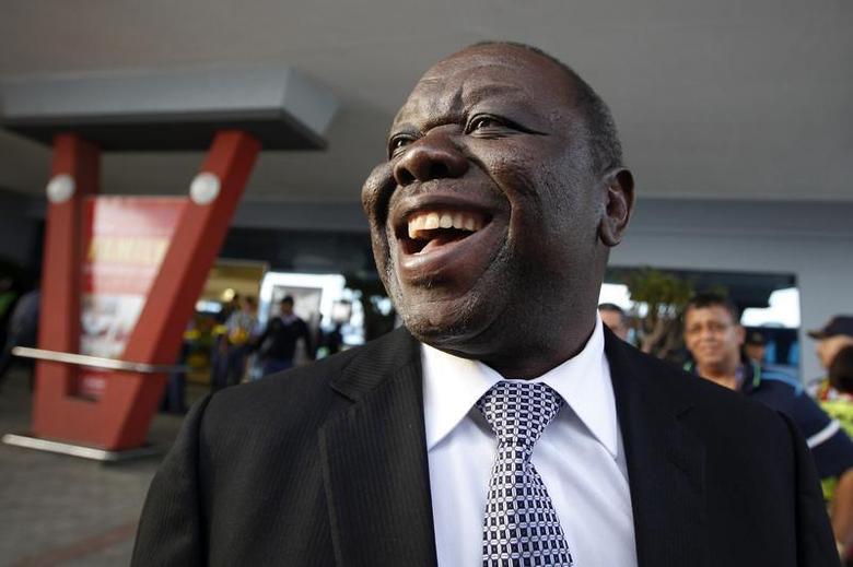 Zimbabwe's Prime Minister Morgan Tsvangirai arrives at East London airport in Eastern Cape, December 14, 2013. REUTERS/Dai Kurokawa/Pool