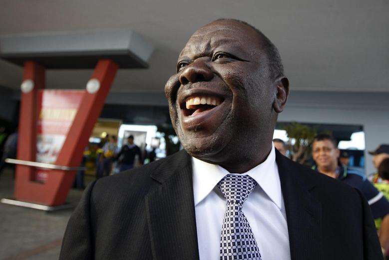 Zimbabwe's Prime Minister Morgan Tsvangirai arrives at East London airport in Eastern Cape, December 14, 2013. REUTERS/Dai Kurokawa/Pool