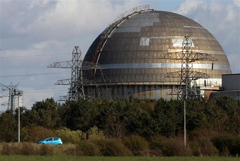 A car passes the Sellafield nuclear reprocessing site near Seascale in Cumbria, England in this April 12, 2011 file photograph. REUTERS/David Moir/Files