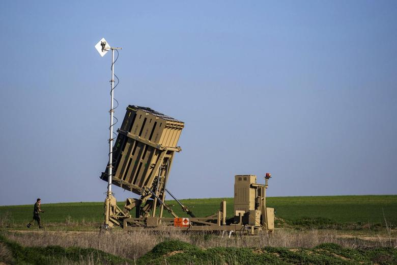An Israeli soldier walks near the launcher of an Iron Dome missile interceptor battery deployed in the southern Israeli coastal city of Ashkelon January 16, 2014. REUTERS/Amir Cohen