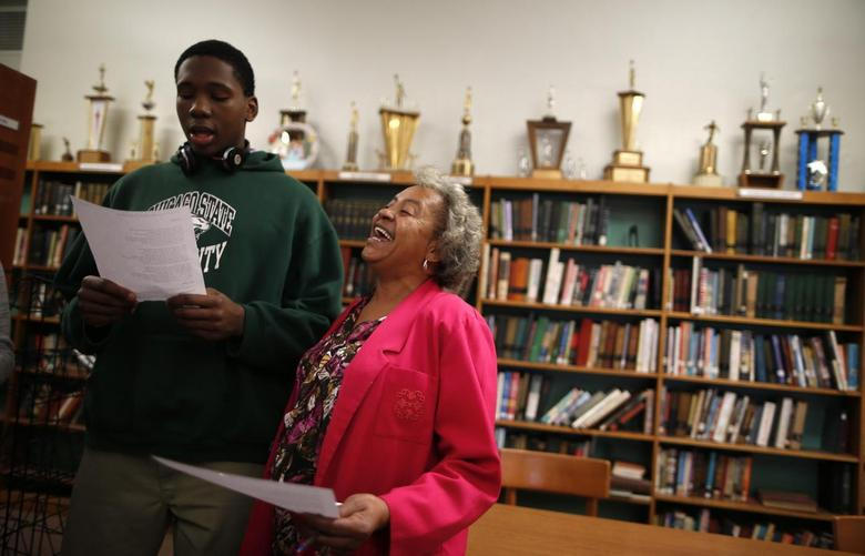 Velma Smith sings with one of the students in the library at Leo Catholic High School in Chicago, Illinois February 14, 2013. REUTERS/Jim Young