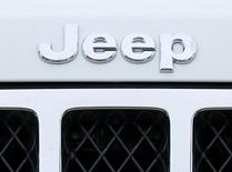The logo on the front of a Jeep vehicle is shown at a Chrysler dealership in Carlsbad, California April 29, 2013. REUTERS/Mike Blake