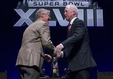 Seattle Seahawks head coach Pete Carroll and Denver Broncos coach John Fox embrace following a news conference ahead of Super Bowl XLVIII in New York January 31, 2014. REUTERS/Brendan McDermid