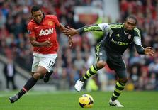 Manchester United's Nani (L) challenged by Stoke City's Wilson Palacios during their English Premier League soccer match at Old Trafford Stadium in Manchester, northern England, October 26, 2013. REUTERS/Nigel Roddis