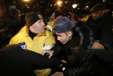 Pop singer Justin Bieber arrives at a police station to face assault charges in Toronto in this file photo taken January 29, 2014. REUTERS/Alex Urosevic/Files