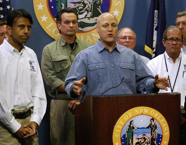 New Orleans Mayor Mitch Landrieu talks about Tropical Storm Isaac as Louisiana Governor Bobby Jindal (L) looks on during a news conference at City Hall in New Orleans, Louisiana, August 27, 2012. REUTERS/Jonathan Bachman